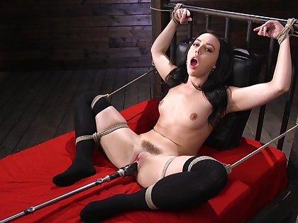 Submissive brunette in rough scenes of fucking machine XXX
