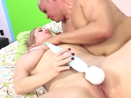 The man with the addition of hot blonde massaging her magnificent cunt