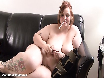 Curvy BBW about nice bore posing seductively on sofa while smoking