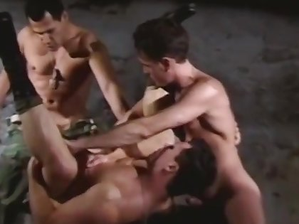 Rough gay gangbang with bondage and handcuffs during the military drill